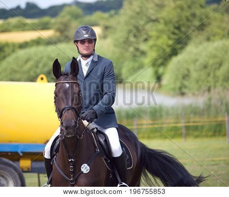 Rider on his horse before showjumping  competition