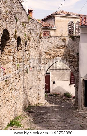 View of typical Motovun stone street and gate Istria. Croatia