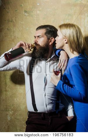 Girl With Glass Of Liqueur Looking At Man Drinking Wine
