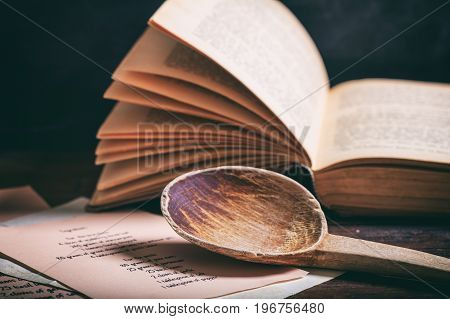 Wooden Spoon And A Vintage Book