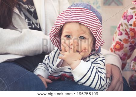 Child with surprised facial expression symbolizing unbelievable expression