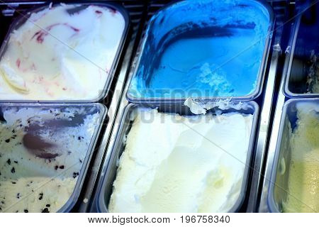 Assorted ice cream flavours on display in an ice cream parlour