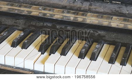 Piano Keyboard Broken Old Piano Covered With Dust And Dirt In The Interior Of An Abandoned Ruined Co