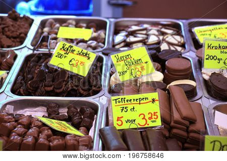 Chocolates on display on a confectioner's market stall (tags: prices and product information in Dutch)