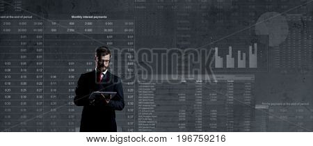 Businessman with computer tablet.  Schematic background. Business and office, concept.