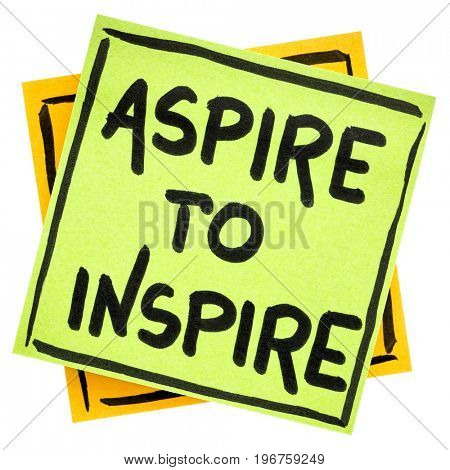 aspire to inspire reminder  - handwriting in black ink on an isolated sticky note