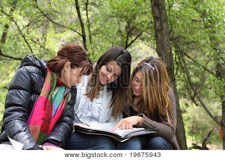 3 Girls Reading Together