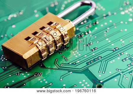 Lock on the background of the computer motherboard, the concept of cyber security