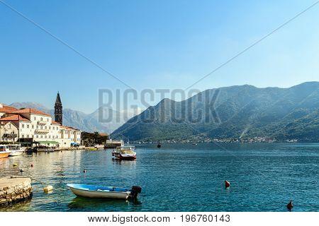 Beautiful sunny day in Perast, Montenegro, mediterranean landscape, Kotor bay (Boka Kotorska), Montenegro, Europe, old historical town and resort.