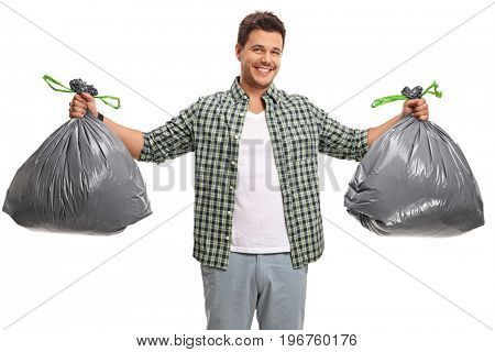 Young guy with two bags of garbage isolated on white background