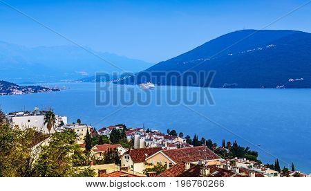 Kotor Bay, Herceg Novi, Montenegro. Sunset time light. Big cruise ship (some motion blur)