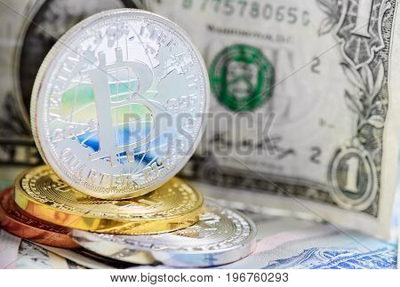 Bitcoin coin over dollar and foreign money background