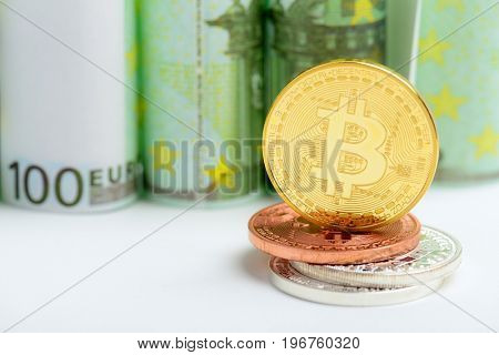 Golden Bitcoin on Euro banknotes money background