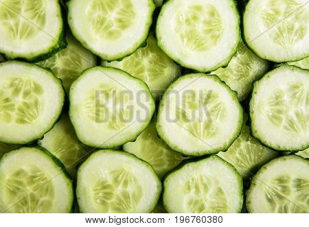 Fresh cucumber slices as background