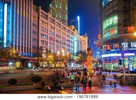 Shanghai, China - Nov 4, 2016: On intersection of Fengyang Road and Xizang Road (Middle) - in evening neon lights. Street photography.