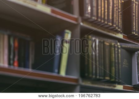 Blurred abstract background of Many books, textbooks or fiction volumes Fiction in book store or in library. Concept of education, school, study, self-study