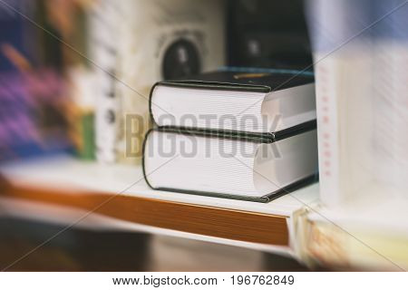 Blurred abstract background of Two thick volumes Fiction in book store or in library. Concept of education, school, study, self-study