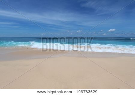 Bali beach with whate sand and blue waves in Bukit