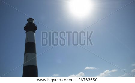 View of Bodie Lighthouse with sun flair, Nags Head, Outer Banks, North Carolina USA
