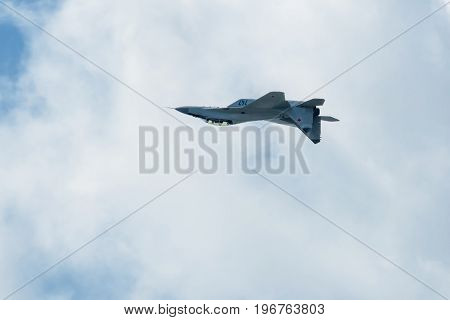 Moscow Region - July 21, 2017: Russian strike fighter MIG-29 flies upside down at the International Aviation and Space Salon (MAKS) in Zhukovsky.