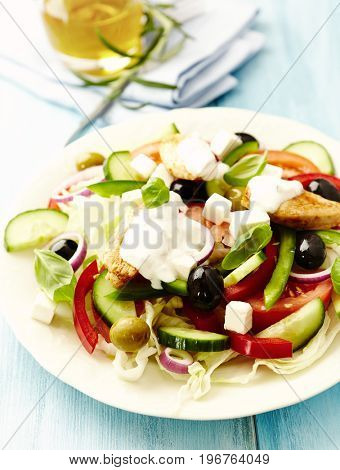 Chicken salad with tzatziki and basil leaves