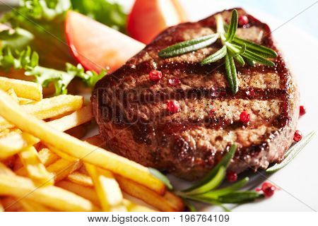 Grilled beefsteak witch french fries