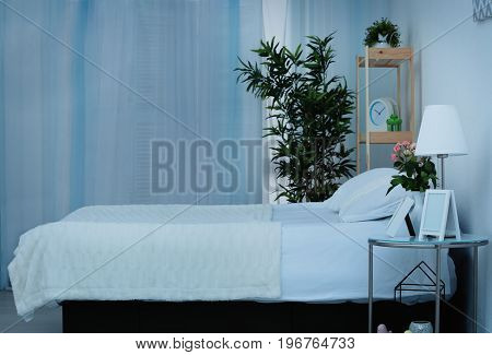 Comfortable bed with pillows in bedroom