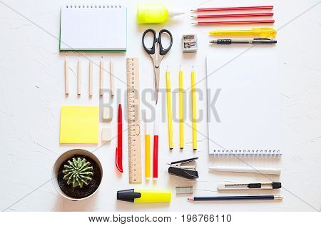 School thing are on the table, colorful and with space for a text.