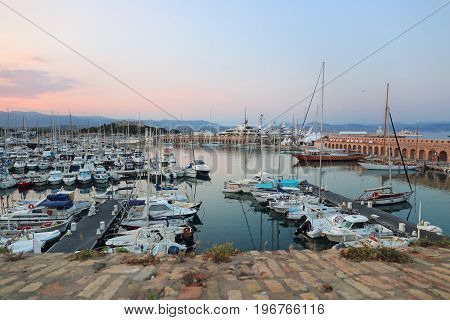 Southern France landscape of French Riviera. Antibes view of the old port and yachts sunset