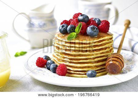 Homemade Pancakes With Honey And Fresh Berries.