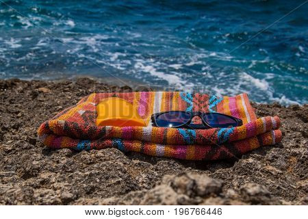Summer, Blue Sea, Beach Towel, Sunscreen And Glasses
