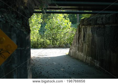 Old underpass beneath railroad tracks along Blackstone River Bikeway