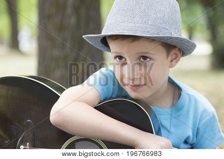 He Learns To Play Guitar