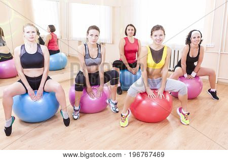 Sport and Fitness Concepts and Ideas. Group of Five Caucasian Female Athletes Having Exercises With Fitballs in Gym Together.Horizontal Shot