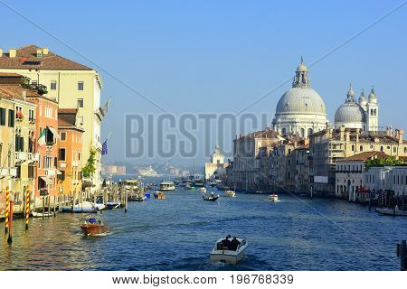 Venice Italy,October 16th 2013.The busy grand Canal in Venice with boats gondolas and other watercraft sailing past high end real estate hotels and churches.Come to Venice and be a tourist and enjoy this romantic city and make lifelong memories of your ow
