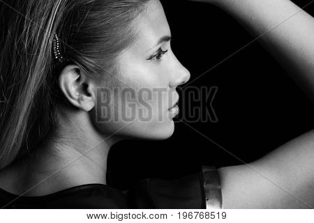 young beautful blonde girl portrait profile in black and white studio shot