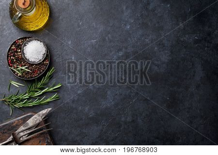 Cooking ingredients and utensils on stone table. Top view with copy space for your recipe