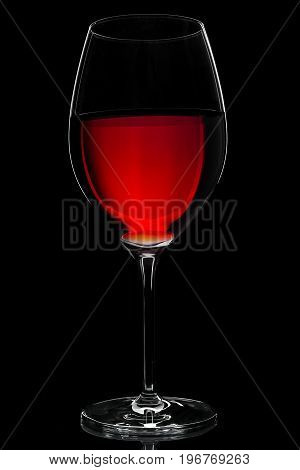 wine glass with red wine on black backround