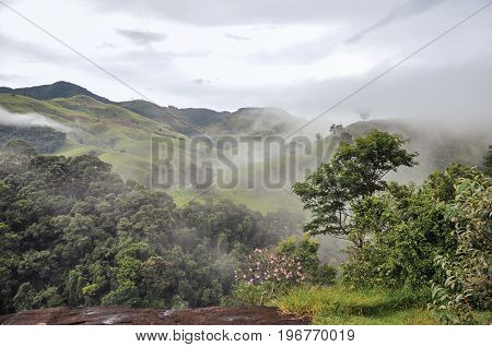 Overview of Forest and hills shrouded by mist and clouds near the town of Joanópolis. In the countryside of São Paulo State, a region rich in agricultural and livestock products, southwestern Brazil