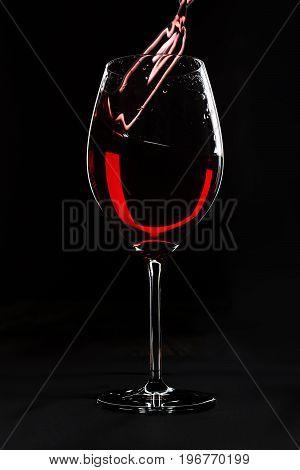 Red wine splash up on black background