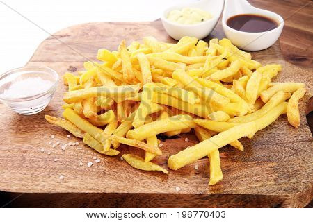 Close Up Crispy Potato Fries With Two Dipping Sauce, Served On Rustic Wooden Table