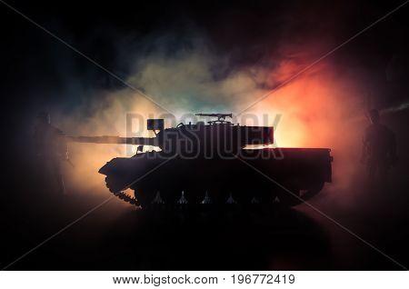 War Concept. Military Silhouettes Fighting Scene On War Fog Sky Background, World War German Tanks S