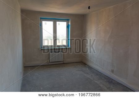 Photo of a rough-finished room in a newly built residential building