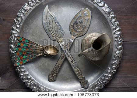 Retro Silver Kitchen Utensil With Ornaments On Silver Tray