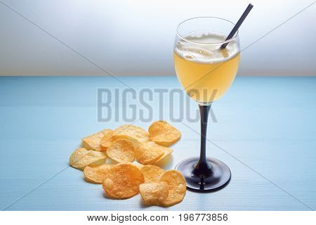 Glass Of Golden Ale Beer With Crisps