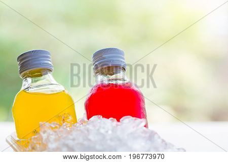 Bottle With Tasty Drink In Ice