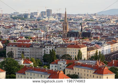 Aerial view of the district Landstrasse (third municipal district of Vienna) with the St.Othmar Church in the center and a lot of construction cranes on the horizon. Vienna, Austria.