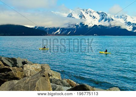 A view of some sea kayakers in Resurrection bay in Seward Alaska