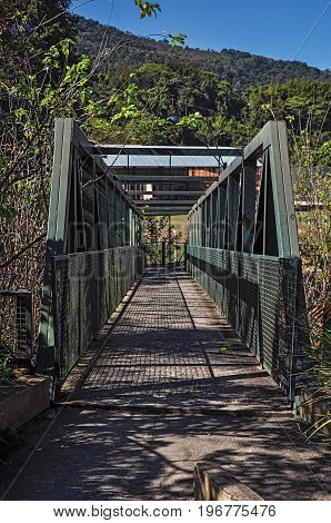 View of iron bridge over small river at Monte Alegre do Sul. In the countryside of São Paulo State, a region rich in agricultural and livestock products, southwestern Brazil