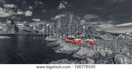 Panorama Of  Reine On The Lofoten In Northern Norway. The Typical Norwegian Fishing Village Of Reine With The typical Rorbu House - Black and White Style